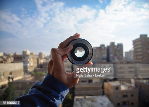 Cropped Hand Holding Camera Lens