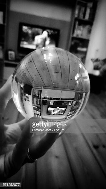Cropped Hand Holding Crystal Ball At Home
