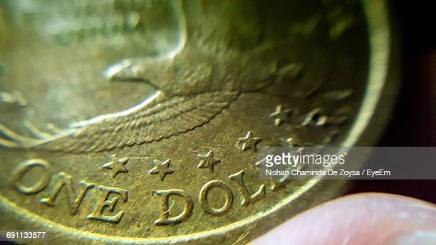 Cropped Hand Holding One Us Dollar Coin