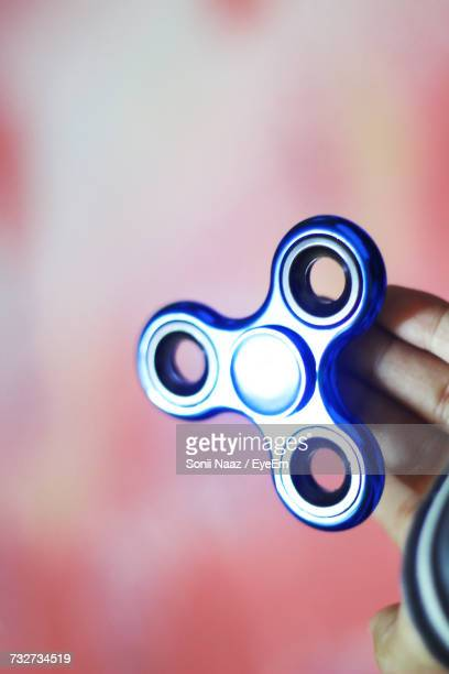 Cropped Hand Holding Spinner Toy