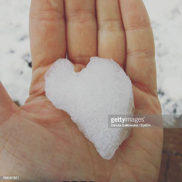 Cropped Hand Of Person Holding Snow
