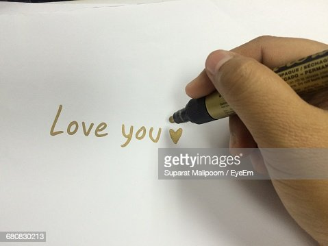Cropped Hand Of Person Writing Love You On Paper With Gold Colored – Colored Writing Paper