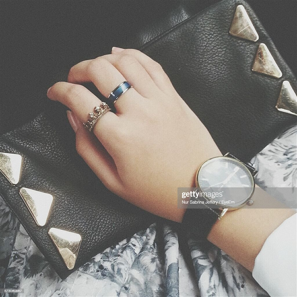 Cropped Hand Of Women Holding Clutch
