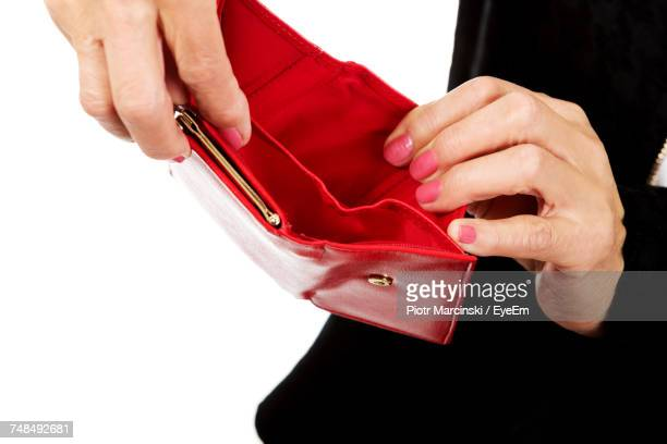 Cropped Hands Of Woman Holding Empty Red Wallet Against White Background