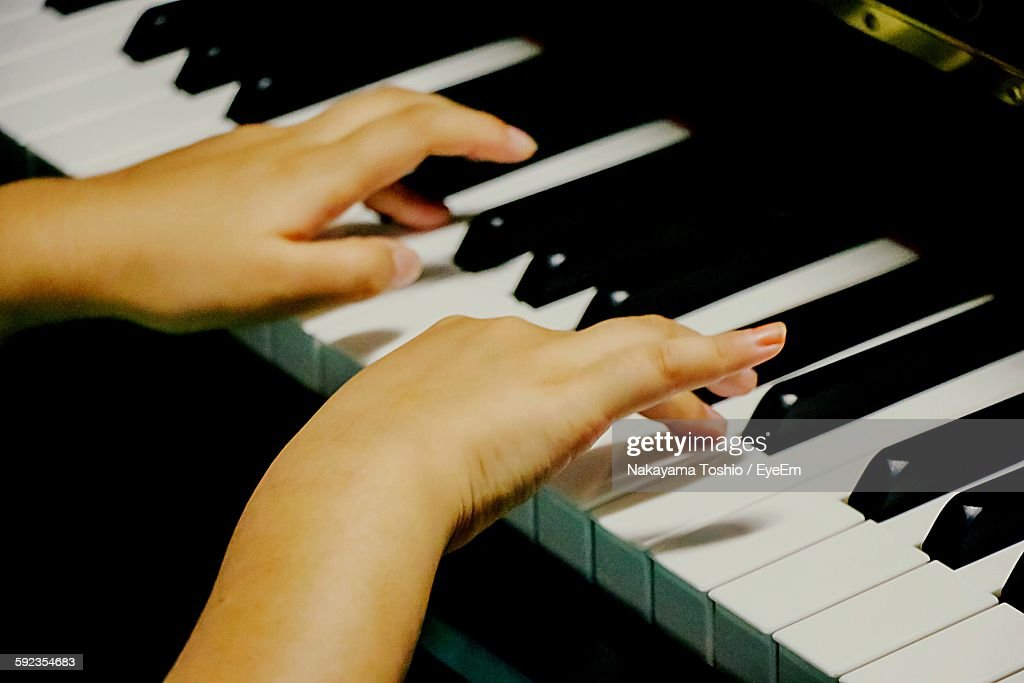 Cropped Hands Of Woman Playing Piano