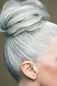 Cropped image of a grey haired bun.