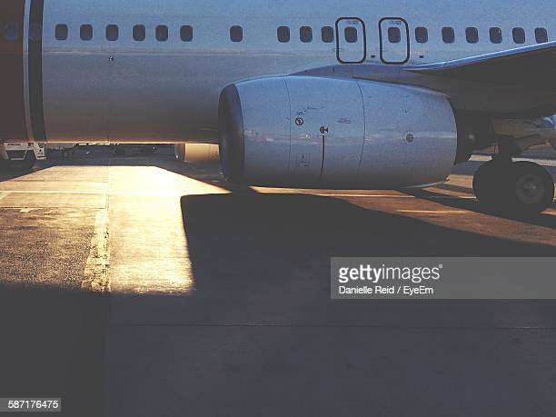 Cropped Image Of Airplane On Runway With Sunlight At Stockholm Arlanda Airport
