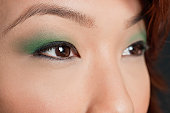 Cropped image of Asian woman looking away