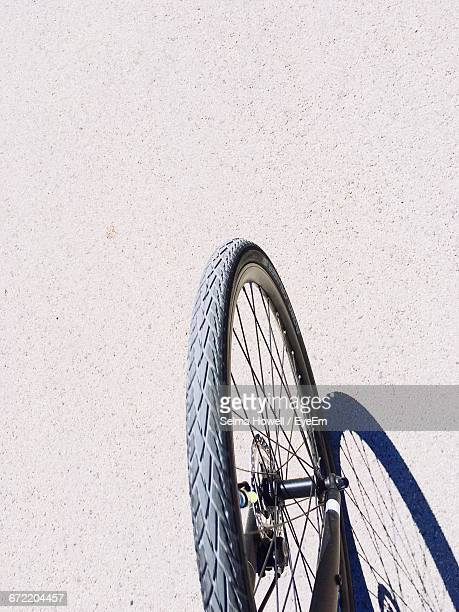 Cropped Image Of Bicycle On Street During Sunny Day