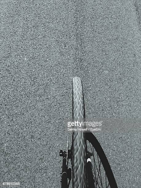 Cropped Image Of Bicycle Tire On Street