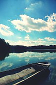 Cropped Image Of Boat In Lake Against Cloudy Blue Sky