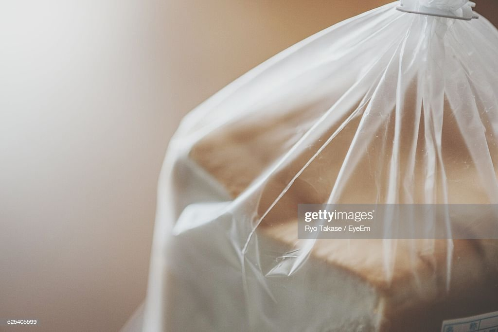 Cropped Image Of Bread Slices In Plastic Bag