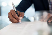 Cropped image of businessman signing paperwork