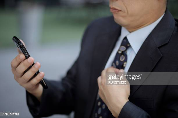 Cropped image of businessman using smartphone