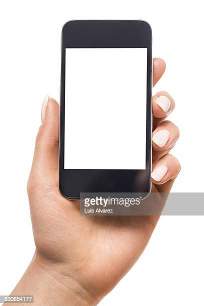 Cropped image of businesswoman holding smart phone