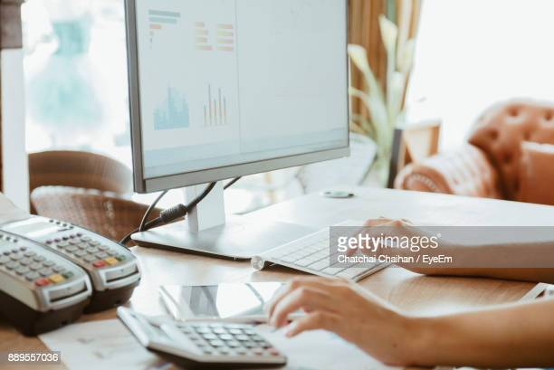 Cropped Image Of Businesswoman Working On Computer At Office