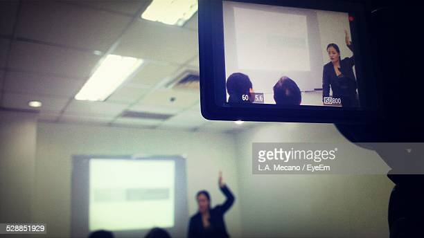 Cropped Image Of Camera Recording Conference In Office