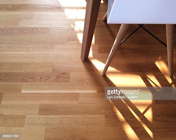 Cropped Image Of Chair On Hardwood Floor