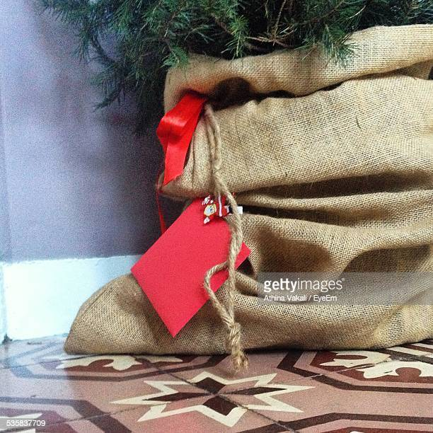 Cropped Image Of Christmas Tree In Sack