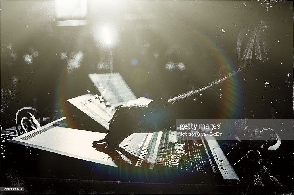 Cropped Image Of Dj Performing On Stage