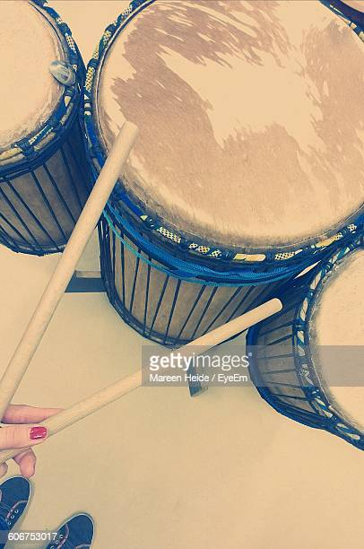 Cropped Image Of Girl Playing Drum