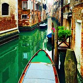 Cropped Image Of Gondola Moored In Grand Canal Against Buildings