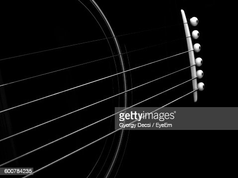 Cropped Image Of Guitar Strings Against Black Background
