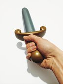 Cropped image of hand holding toy sword