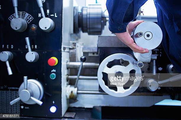 Cropped image of hand operating machinery