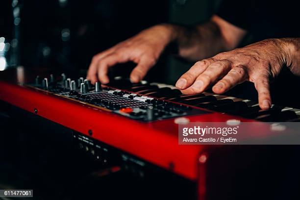 Cropped Image Of Hand Playing Piano