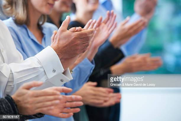 Cropped image of hands clapping