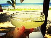 Cropped Image Of Hands Holding Margarita In Glass