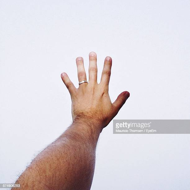 Cropped Image Of Man Hand Against White Background