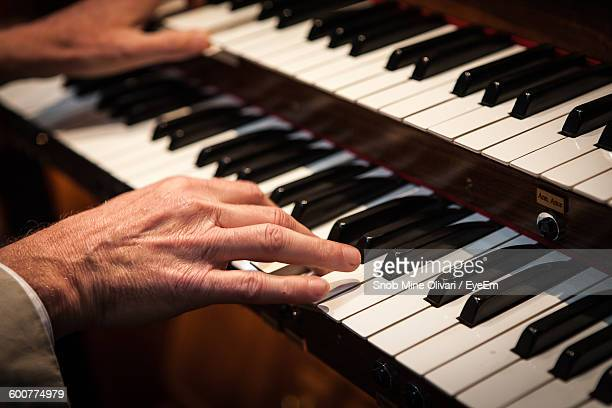Cropped Image Of Man Playing Piano