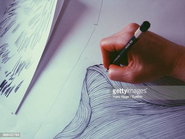 Cropped Image Of Person Drawing On Paper