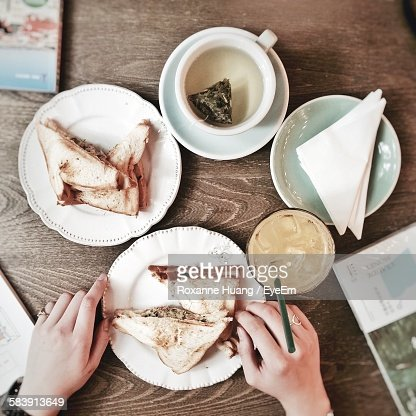 Cropped Image Of Person Having Breakfast At Home : Stock Photo