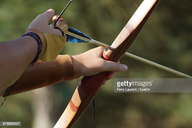 Cropped Image Of Person Holding Archery Bow