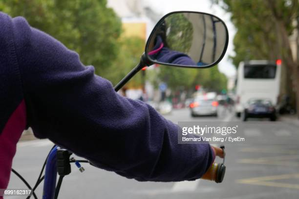 Cropped Image Of Person Riding Motorcycle On Street
