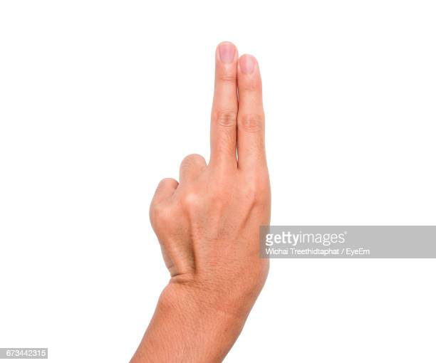Cropped Image Of Person Showing Two Fingers Against White Background