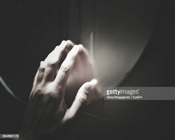 Cropped Image Of Person Touching Mirror