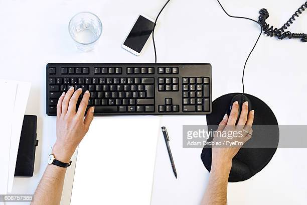 Cropped Image Of Person Using Computer At Office