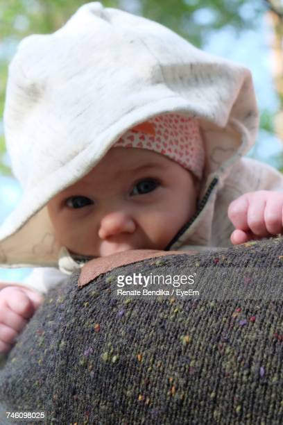 Cropped Image Of Person Wearing Sweater Carrying Baby