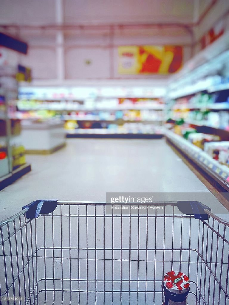 Cropped Image Of Shopping Cart In Supermarket