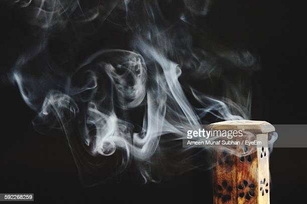 Cropped Image Of Smoke From Wood Against Black Background