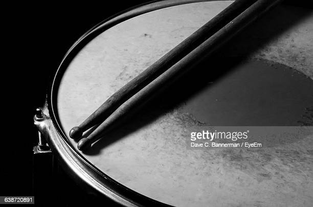 Cropped Image Of Sticks On Snare Drum