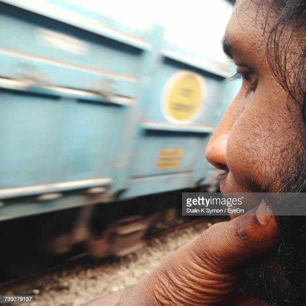 Cropped Image Of Thoughtful Bearded Man Looking At Train