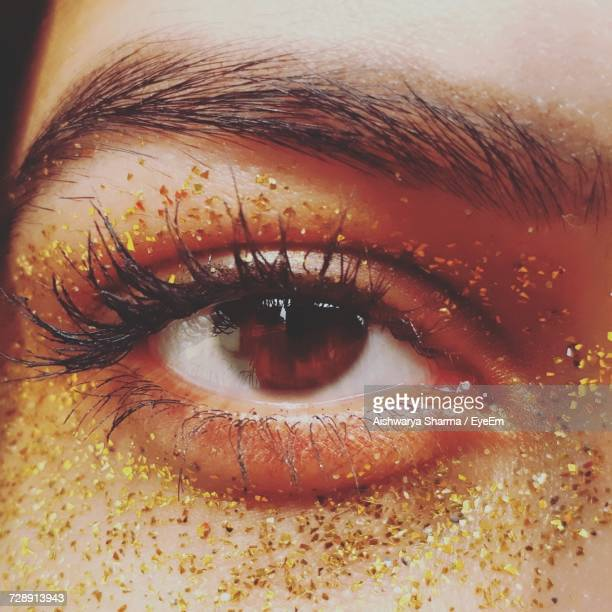 Cropped Image Of Woman Eye With Glitters