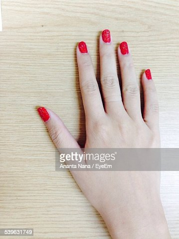Cropped Image Of Woman Hand On Table