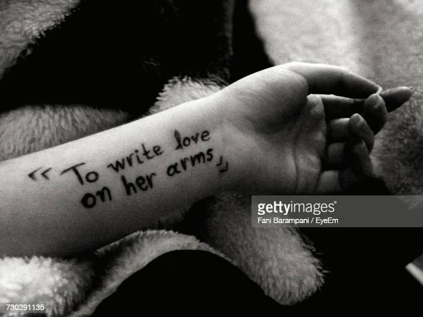 Cropped Image Of Woman Hand With Text