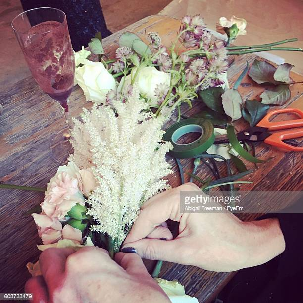 Cropped Image Of Woman Hands Making Bouquet